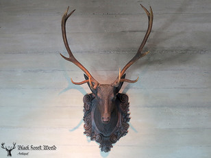 carved black forest stag head