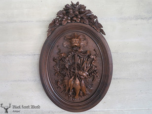 large black forest carved plaque